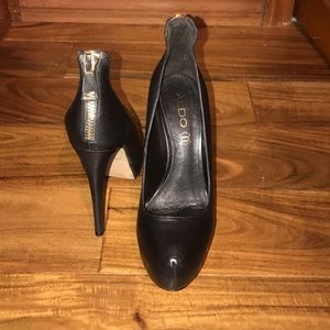 ALDO black leather platform heel w/zipper on back